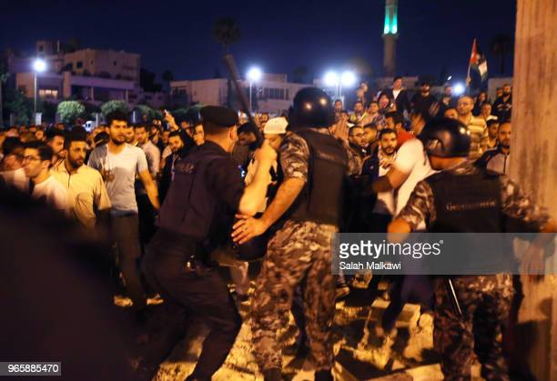 Jordanians protest near the prime minister's office refusing an income tax law on June 1 2018 in Amman Jordan Jordanians on Wednesday executed a...