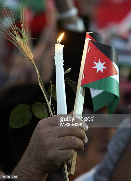 Jordanians stage 13 November 2005 a silent demonstration to commemorate the victims of the terrorist attacks last wednesday in Amman Jordan's King...