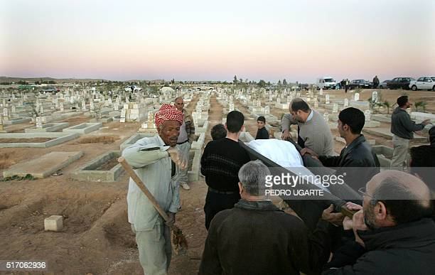 Jordanians take part in the funeral of a victim of last night's triple bombing attacks on hotels in the Jordanian capital at a cemetery in Amman 10...
