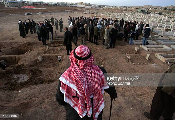 Jordanians take part in the funeral of three victims from the Abdul Latif family at a cemetery in Amman 10 November 2005 following last night's...