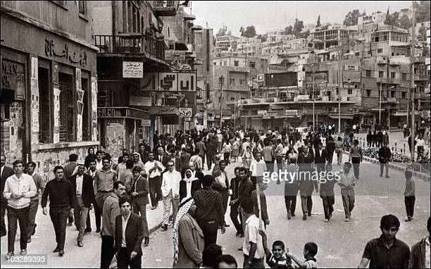 Jordanians walk in a Amman street 20 October 1970 as the situation comes back to normal after the fights between the Jordanian army and Palestinian...