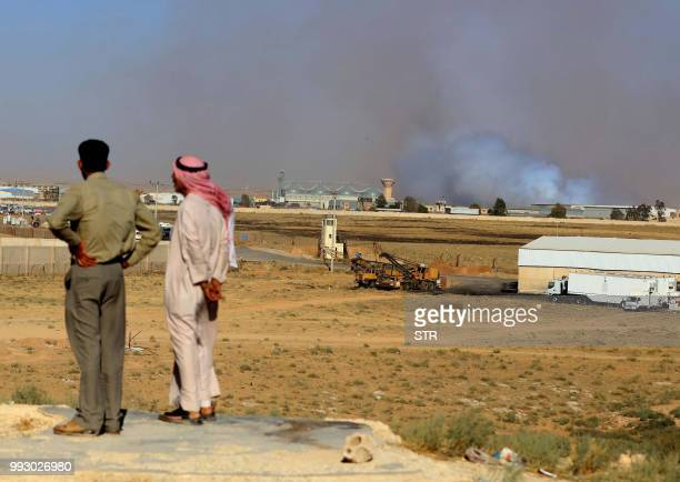 Jordanians watch as smoke rises above the southern Syrian province of Deraa from the Jordanian side of the Nassib border on June 7 2018 Syria's...