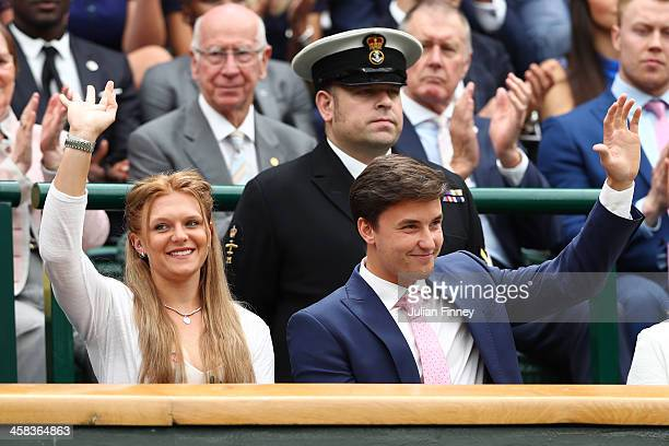 Jordanne Whiley and Gordon Reid are announced to the crowed on centre court on day six of the Wimbledon Lawn Tennis Championships at the All England...