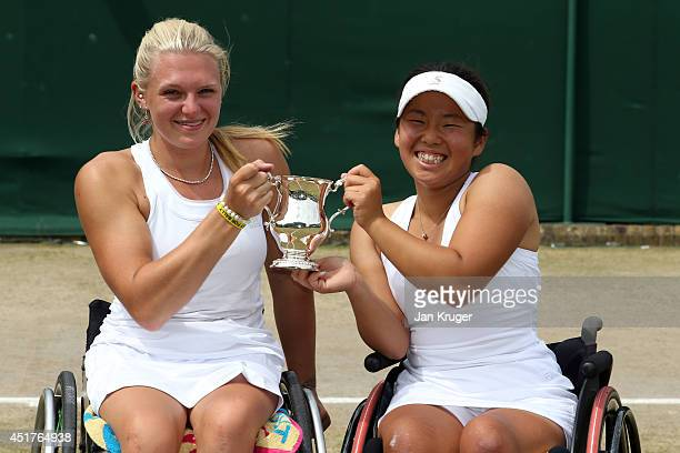Jordanne Whiley of Great Britain and Yui Kamiji of Japan celebrate with the trophy after winning their Ladies' Wheelchair Doubles Final match against...