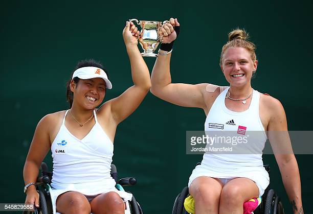 Jordanne Whiley of Great Britain and Yui Kamiji of Japan hold their trophy folllowing victory in the Ladies Doubles Wheelchair Final against Jiske...