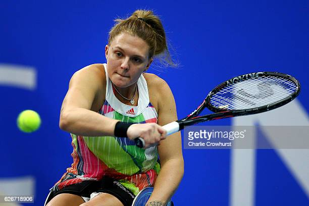 Jordanne Whiley of Great Britain in action during her singles match against Aniek Van Koot of Holland on Day 1 of NEC Wheelchair Tennis Masters at...