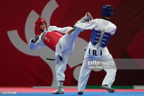 Jordan's Ahmad Abughaush against Iran's Amirmohammad Bakhshikalhori during the Taekwondo men's 68kg category semifinals on day five of the Asian...