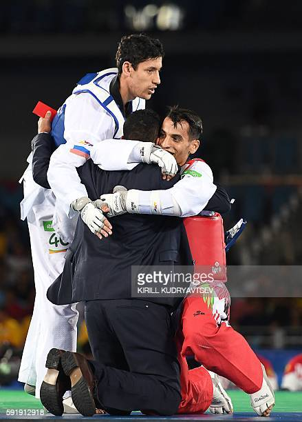 Jordan's Ahmad Abughaush celebrates after winning against Russia's Alexey Denisenko in the men's taekwondo gold medal bout in the 68kg category as...