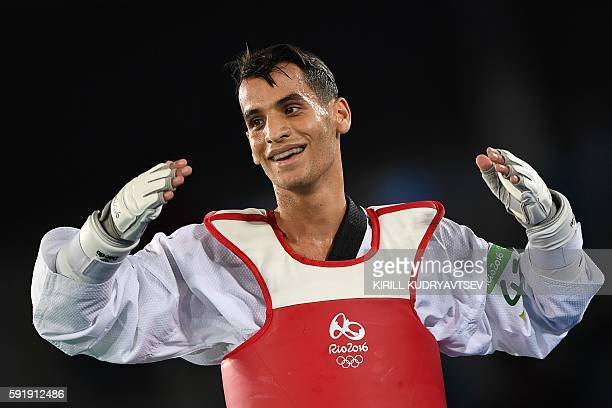 Jordan's Ahmad Abughaush celebrates after winning the men's taekwondo gold medal match in the 68kg category as part of the Rio 2016 Olympic Games on...