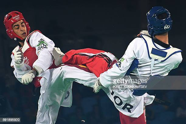 Jordan's Ahmad Abughaush competes against Spain's Joel Gonzalez Bonilla during their men's taekwondo semifinal bout in the 68kg category as part of...