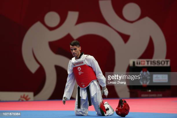 Jordan's Ahmad Abughaush reacts against Iran's Amirmohammad Bakhshikalhori during the Taekwondo men's 68kg category semifinals on day five of the...