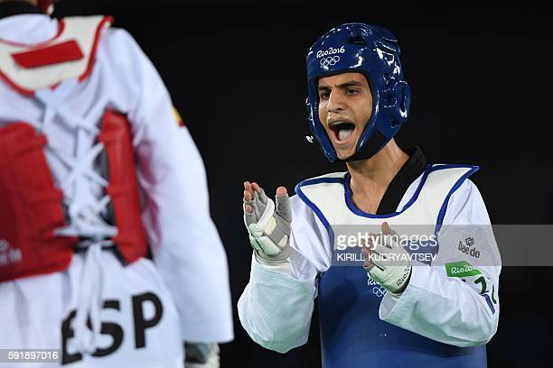 Jordan's Ahmad Abughaush reacts as he competes against Spain's Joel Gonzalez Bonilla during their men's taekwondo semifinal bout in the 68kg category...