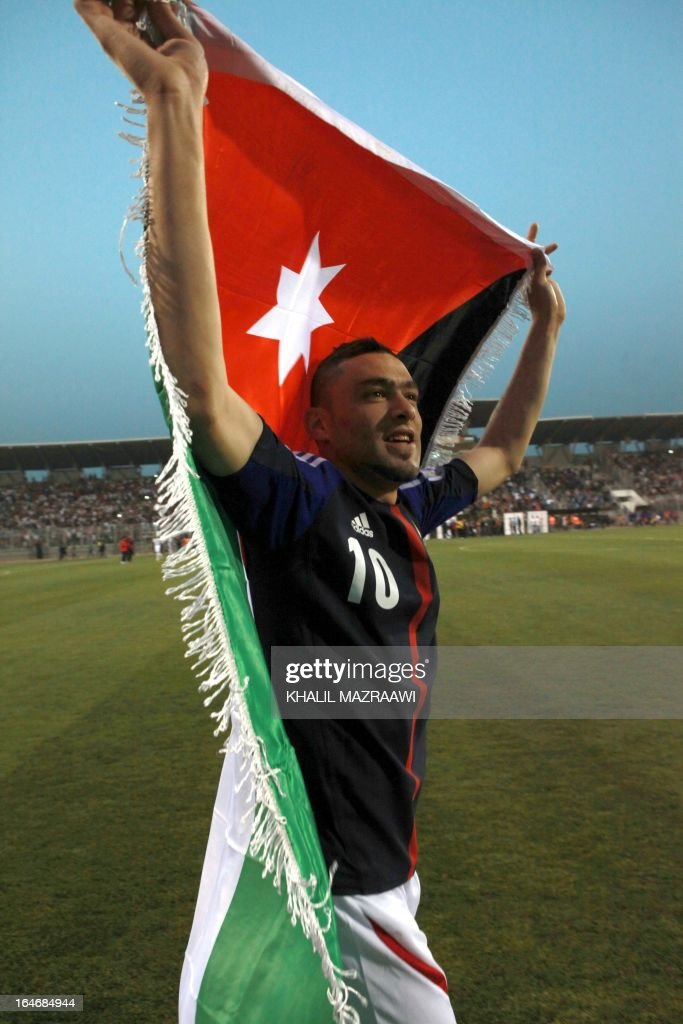 Jordan's Ahmad Ibrahim (10) celebrates after beating Japan 2-1 following their FIFA World Cup Group B Asian qualifiers round four football match, in Amman, on March 26, 2013.