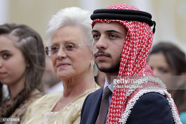 Jordan's Crown Prince Hussein sits next to his paternal grandmother Princess Mona during a ceremony to celebrate the country's 69th Independence Day...