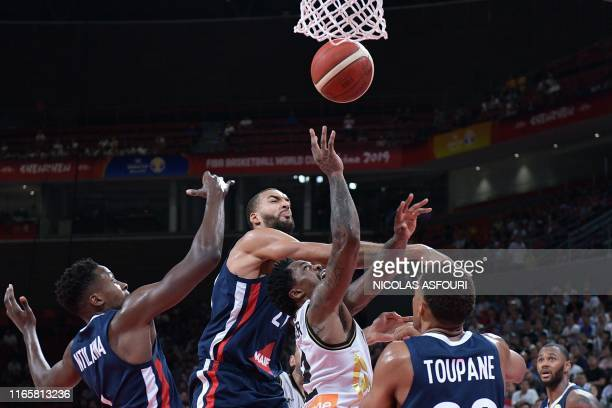Jordan's Dar Tucker reaches for the ball as France's Rudy Gobert reacts during the Basketball World Cup Group G game between Jordan and France in...