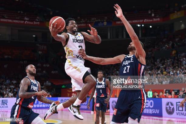 Jordan's Dar Tucker takes a shot as France's Rudy Gobert tries to block during the Basketball World Cup Group G game between Jordan and France in...
