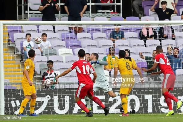 Jordan's defender Anas Bani Yaseen heads the ball and scores during the 2019 AFC Asian Cup football game between Australia and Jordan at the Hazza...