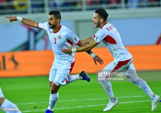 Jordan's defender Tareq Khattab celebrates his goal his team's second during the 2019 AFC Asian Cup group B football match between Jordan and Syria...