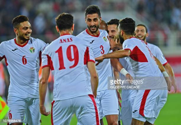 Jordan's defender Tareq Khattab celebrates his goal his team's second with teammates during the 2019 AFC Asian Cup group B football match between...