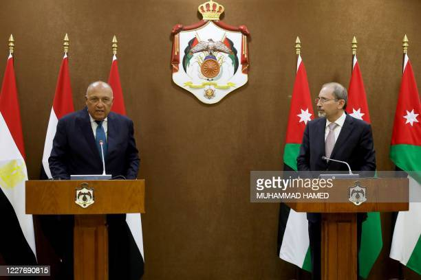 Jordan's Foreign Minister Ayman Safadi listens to Egypt's Foreign Minister Sameh Shoukry during a press conference in the capital Amman on July 19,...
