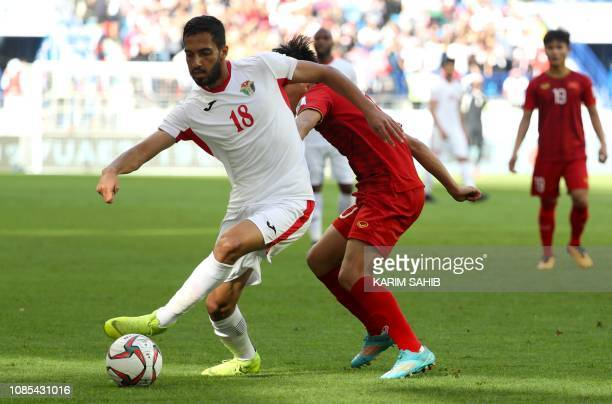 Jordan's forward Mousa Suleiman dribbles past Vietnam's forward Van Duc Phan during the 2019 AFC Asian Cup Round of 16 football match between Jordan...