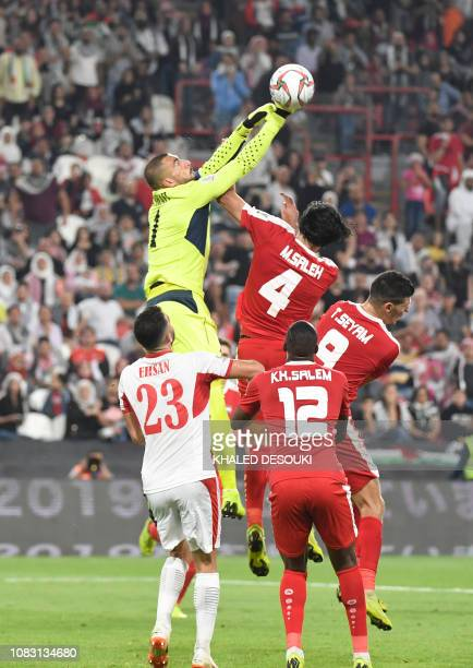 Jordan's goalkeeper Amer Shafi jumps to punch the ball clear during the 2019 AFC Asian Cup group B football match between Palestine and Jordan at the...