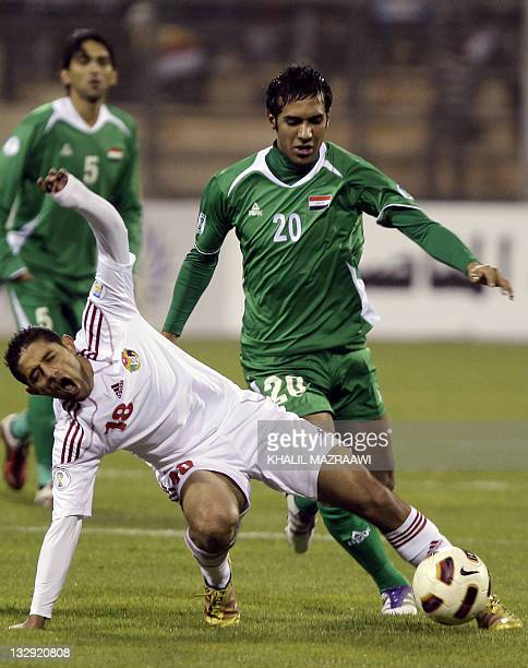 Jordan's Hassan Mahmud is challenged by Iraq's Muthana Khaled during their 2014 World Cup Asian zone group A qualifying football match in Amman on...