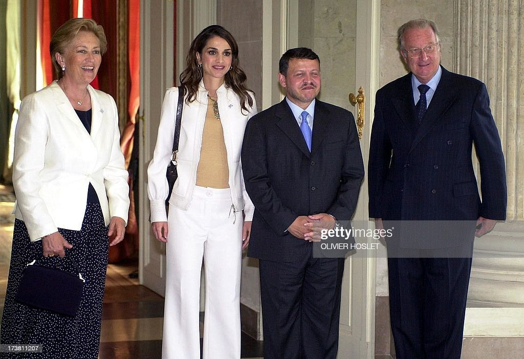Jordan's King Abdallah II (2nd R) and Queen Rania (2nd L) pose 11 June 2002 with Belgium's King Albert II (R) and Queen Paola (L) at the Royal Castle of Laeken, near Brussels. King Abdallah II and Queen Rania are on a one-day visit to Belgium.