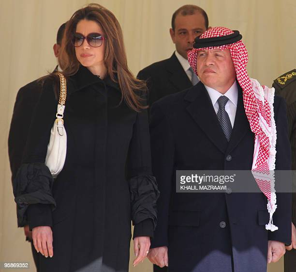 Jordan's King Abdullah and his wife Queen Rania attend a ceremony for three Jordanian peacekeepers killed in the Haiti earthquake upon the coffins...