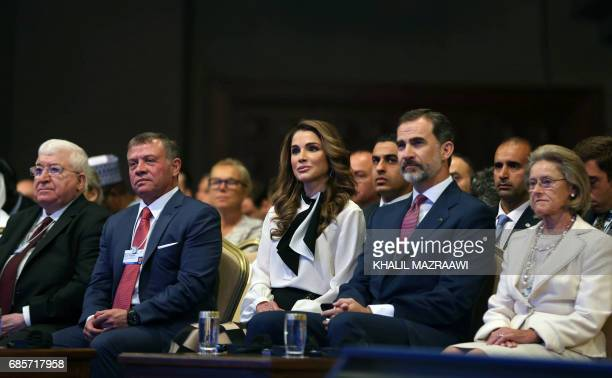 Jordan's King Abdullah II and his wife Queen Rania attend the opening session of the World Economic Forum held in the Dead Sea resort of Shuneh west...
