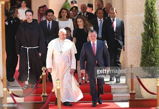 Jordan's King Abdullah II and his wife Queen Rania welcome Pope Francis upon his arrival at the royal palace on May 24 2014 in Amman Jordan during...