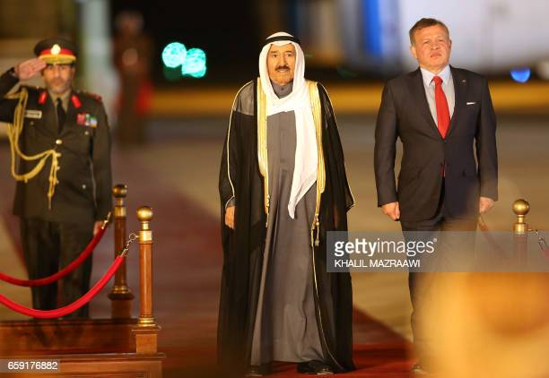 Jordan's King Abdullah II and Kuwaiti Emir Sabah alAhmad alJaber alSabah attend a welcome ceremony at the Queen Alia International Airport in Amman...