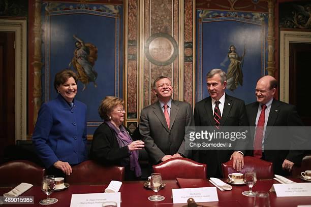 Jordan's King Abdullah II laughs with members of the Appropriations Committee Sen Jeanne Shaheen Chairman Barbara Mikulski Sen Mike Johanns and Sen...