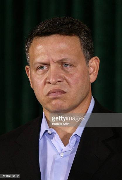 Jordan's King Abdullah II listens as United States President George W Bush speaks to reporters after hosting a meeting at the presidential retreat...