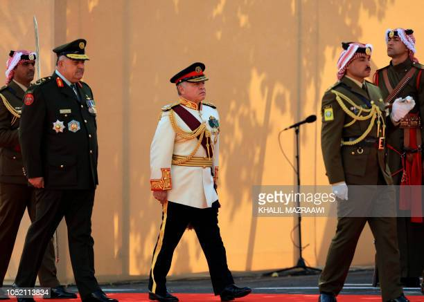 TOPSHOT Jordan's King Abdullah II salutes the honour guard upon his arrival at parliament for the third regular session session in the capital Amman...