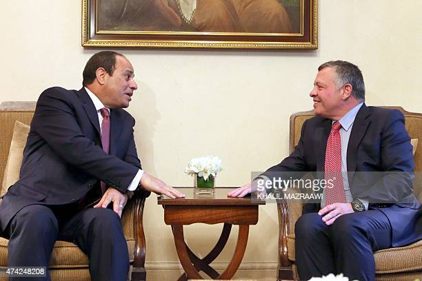 Jordan's King Abdullah II speaks with Egyptian President Abdel Fattah alSisi during a meeting in Amman following the latter's arrival for the opening...