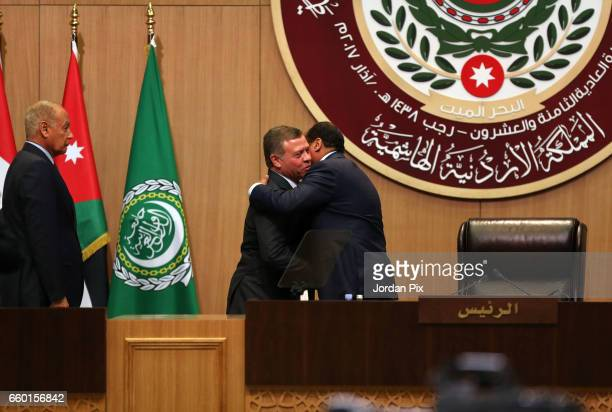Jordan's King Abdullah II takes on the presidency of the 28th Arab League summit from Mauritanian President Mohamed Ould Abdel Aziz as he is greeted...