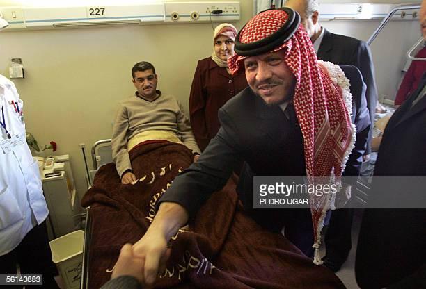 Jordan's King Abdullah II visits victims of the hotel bombings at a Jordan hospital 11 November 2005 AlQaeda said today that four Iraqis including a...