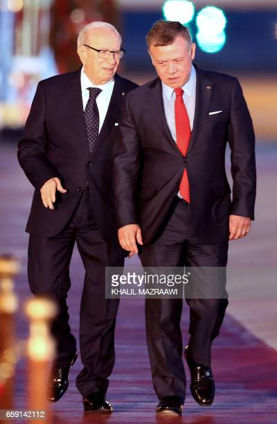 Jordan's King Abdullah II welcomes Tunisian President Beji Caid Essebsi during a welcome ceremony at the Queen Alia International Airport in Amman on...