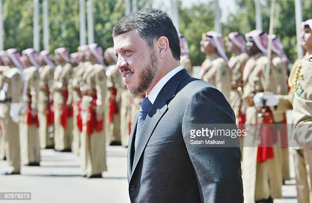 Jordan's King Abdullah reviews a Bedouin honour guard upon his arrival at a ceremony to celebrate the 59th anniversary of the independence of Jordan...