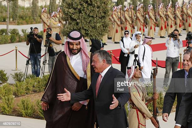 Jordan's King Abdullah speaks with Saudi Arabia's Deputy Crown Prince Mohammed bin Salman upon his arrival at the Royal Palace on August 4 2015 in...