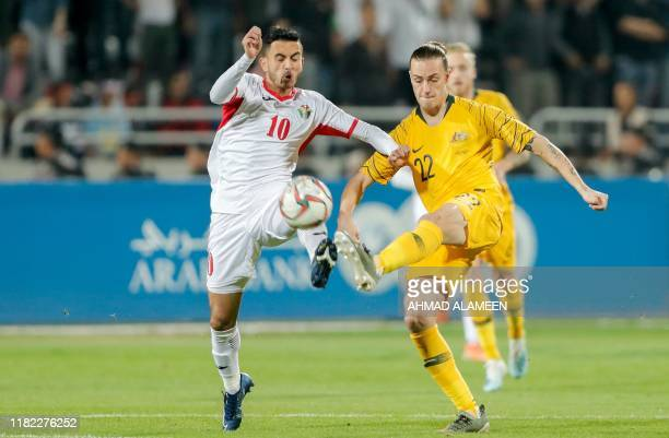 Jordan's midfielder Ahmed Samir vies for the ball with Australia's midfielder Jackson Irvine during the Group B FIFA World Cup 2022 andthe 2023 AFC...