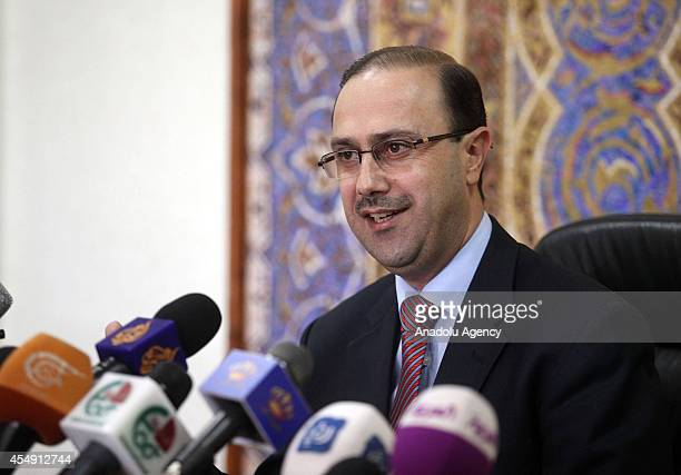 Jordan's Minister of State for Media Affairs Mohammad Momani speaks to press in Amman Jordan on September 7 2014