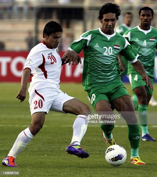 Jordan's national team player Hamza alDardour vies for the ball against Iraq's national team player Muthana Khalid Salih during their 2014 World Cup...