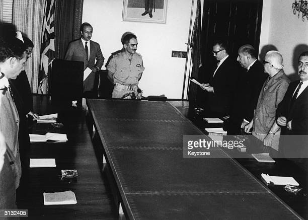 Jordan's new cabinet takes the constitutional oath before King Hussein at the Royal Court in Amman, 1st July 1970. Reading the oath is new premier...