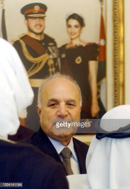 Jordan's new Prime Minister Adnan Badran is congratulated by tribal Bedouin leaders in Amman 10 April 2005 Badran and his 25member government were...