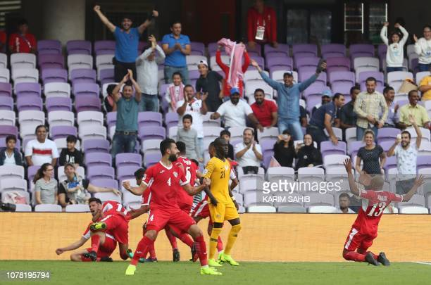 Jordan's players celebrate after scoring a goal during the 2019 AFC Asian Cup football game between Australia and Jordan at the Hazza Bin Zayed...