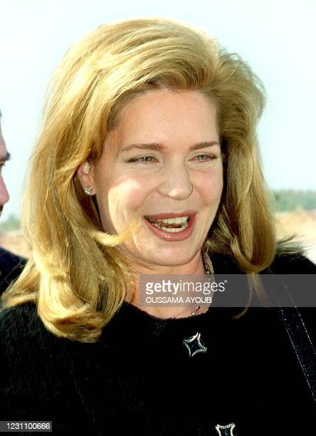 Jordan's Queen Noor, widow of the late King Hussein, smiles upon her arrival at Beirut International airport 27 October 1999. The queen is on a...
