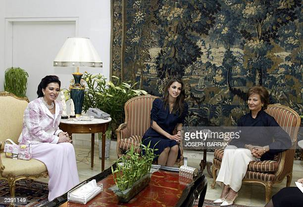 Jordan's Queen Rania AlAbdullah meets 15 June 2003 with Lebanese First Lady Andre Emile Lahoud and the wife of the Prime Minister Nazik Rafiq Hariri...