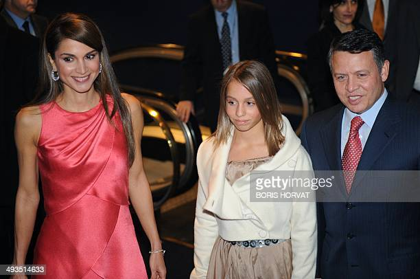 Jordan's Queen Rania and her husband King Abdullah II pose with their daughter Iman at the Paris' premiere of the latest James Bond movie 'Quantum of...
